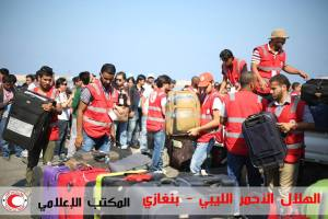 Red Crescent volunteers helping foreign workers evacuate Benghazi
